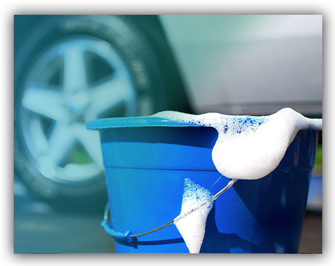Blue bucket filled with all natural extreme water saving car wash